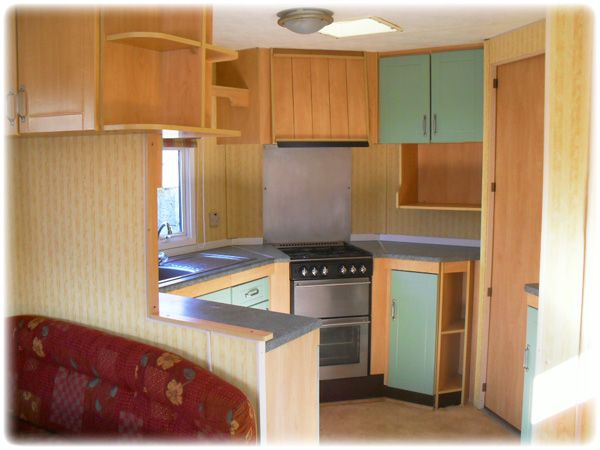 oak and green wooden kitchen