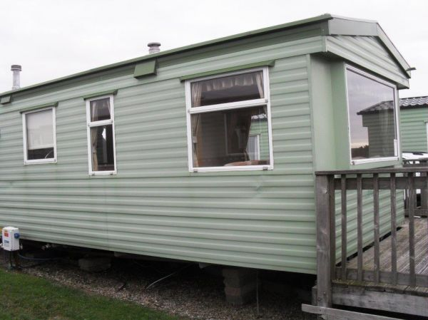 green caravan with decking