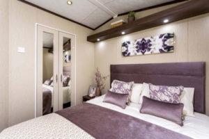 caravan bedroom purple in colour